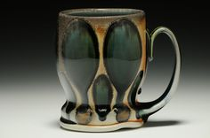 I would use it for coffee or holding my paint brushes. Beer Mug