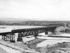 An A-B-B-A set of Santa Fe EMD F-units leads a reefer block across the Colorado River in the 1950s. ATSF Railway Photo.