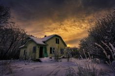 abandoned and cold forgotten home at sunrise.
