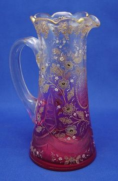 *MOSER ~ Early Bohemian, Cranberry Glass Pitcher, Cranberry fading up to clear cut glass with embossed gilt and enamel floral decoration.
