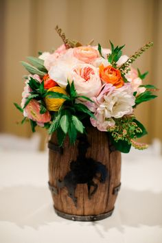 Rustic barrel centerpieces: http://www.stylemepretty.com/wyoming-weddings/cheyenne/2014/01/02/cheyenne-depot-museum-wedding/ | Photography: Luke & Cat - http://lukeandcat.com/