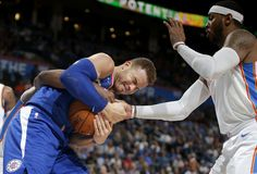 /LA Clippers\' Blake Griffin (32) fights for the ball beside Oklahoma City\'s Carmelo Anthony (7) during an NBA basketball game between the Oklahoma City Thunder and the Los Angeles Clippers at Chesapeake Energy Arena in Oklahoma City, Friday, Nov. 10, 2017. Photo by Bryan Terry, The Oklahoman