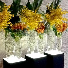 Flower arrangement for office reception. Yellows. For more corporate flower designs please go to www.naomijones.com.au.