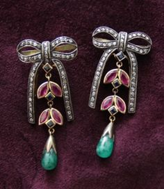 Drop Bow Earrings item:earr0005  Emerald, ruby, sapphire and diamonds White and yellow gold 2″ x 1″ On posts  ca. 1900-1910  $1,100