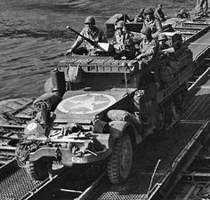 American M3 Half-track vehicle crossing the Seine River in France, 1944.