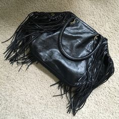 FINAL SALE! ALDO Leather Fringe Purse Retails at $65. Brand new black Aldo purse which has never been used. There is not a single mark or scratch on it. This has been siting in my closet as I have way too many bags! 1 Zipper inside as well as outside the bag. 2 pockets inside the bag for phone etc. Thanks for shopping. ALDO Bags