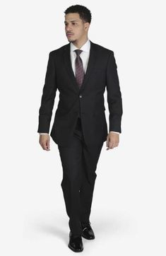 Suit includes jacket & trousers 2-button single breast jacket Notch lapels Flap pockets Side vents Suit includes jacket & trousers Fit: Slim Fit Comfort: Stretch Armhole for comfort Material: 98% Wool 2% Spandex Color: Black Pin Stripe