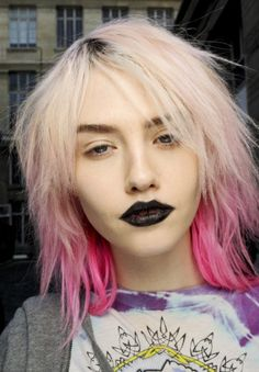 Pink hair and black lips !! Oh this is the perfect look for us.