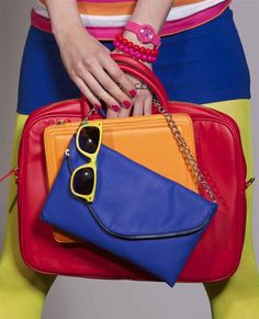 Girls want it all. Laptop bag, tablet case, blue clutch and yellow sun glaces. By Veritas.