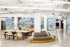 Inside The Coolest Office In Chicago  #refinery29  http://www.refinery29.com/1871-offices#slide9  A communal workspace at 1871, against the backdrop of one of the space's three stunning murals. Photographed by Julia Stotz