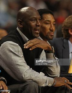 Former players Michael Jordan and Scottie Pippen of the Chicago Bulls watch as the Bulls take on the Charlotte Bobcats at the United Center on...