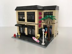 """Hello everyone, today i want you to show my latest creation. I call it """"Miami Surf Shop"""".) I tried to create a modern style Miami building, inspire. Lego Beach, Legoland, Lego Building, Building Ideas, Lego Modular, Cool Lego Creations, Lego Creator, Lego Moc, Lego City"""