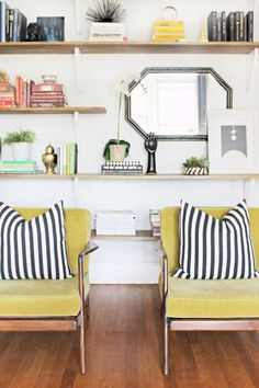 Grellow chairs with black and white striped pillows!