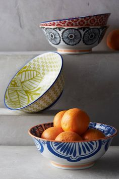 Patterns reminiscent of Spanish tiles in contrasting colors are meant to be mixed and matched for a vivid table. Porcelain with hand painted trim.