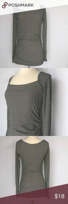 "Ann Taylor Black and white long sleeve print top Gently used Ann Taylor Black and white long sleeve print top size small. No stains, holes or pilling. Length approximately 26"", sleeve length 25"", there's a short zipper at the end of each sleeve. Material is polyester and spandex Ann Taylor Tops Blouses"