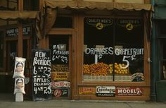 Grand Grocery Co., Lincoln, Nebraska, circa 1942. Photograph shows Rice Krispies cereal boxes in window below oranges; Better Loaf flour sacks at left next to sign for: New & large potatoes, 6lb. 23, apples, delicious, 4lb. 25. John Vachon LC-DIG-fsac-1a34273 www.loc.gov #American #History #Nebraska