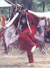 """A Christian of Cherokee descent, Jennifer honors Jesus w/ her heritage. The Fancy Shawl dance is an integral part of Jennifer's ministry. At Native American powwows, festivals, & gatherings, she lives her dedication 2 the belief that when dancing, """"each step is a prayer"""". The crosses that cover her regalia clearly signify Whom she honors. Coupled w/ dancing, she also shares her love of her culture & the Creator through speaking engagements."""