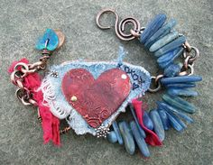 """Staci Louise Originals - bracelet created for the Challenge of Music 2/29/12 inspired by the song """"Bell Bottom Blues"""" performed by Eric Clapton - love the worn and faded jeans, the patina'd heart, the blue stick beads, the swirly clasp."""