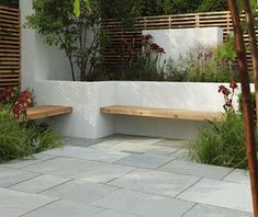 Contemporary hardwood benches built into a white rendered, walled seating/patio area Stonemarket: Garden range: Natural Stone: Trustone Fellstyle Contemporary Garden, Garden Wall, Garden Design, Garden Seating, Garden Spaces, Garden Seating Area, Garden Beds, Wall Seating, Concrete Garden Bench