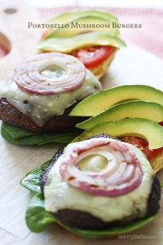 The Best Grilled Portobello Mushroom Burgers - marinated mushrooms grilled w/ melted Swiss Cheese then topped with grilled red onion, tomatoes, spinach, and avocado – yum! Use two portobello caps for buns Portobello Mushroom Burger, Grilled Portobello, Veggie Recipes, Cooking Recipes, Healthy Recipes, Spinach Recipes, Noodle Recipes, Think Food, Salads