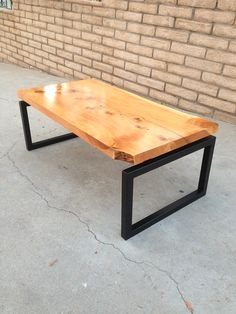 Modern Floating Live Edge Wood Slab Coffee Table Top with steel base. Clear coat natural finish on Alligator Juniper wood. Danish / Scandinavian modern inspired furniture design. Designer/Maker: Leo Bortolini