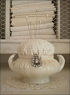 There are no instructions at the link (that I can find) but it looks fairly simple.  One chipped or mismatched sugar bowl, an old crocheted doily, a piece of fringe, an old brooch, and cotton stuffing.  Yup.  It shouldn't be that hard.  Oh, and glue.  Don't forget the glue.  ;-)