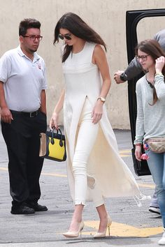Who: Kendall Jenner What: A Long Tunic Over Trousers Why: Jenner is elegant in slim pants layered with a knit tunic by The Row, over Sophia Webster shoes. Get the look now: The Row tunic, $3,690, net-a-porter.com.   - HarpersBAZAAR.com
