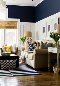 Navy living room decor.Bamboo blinds and ivory sofa can be combined with retro colors like mustard, it can also be part of a more retro 1970's interior.