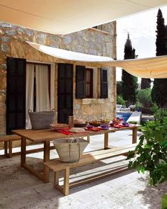 shade cloth over seating area- affix from house to fence