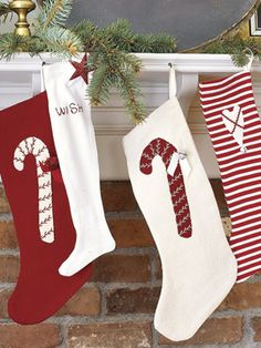 Sweet Stockings  Red-and-white stockings with candy-inspired accents hung by the fire add a classic touch to holiday décor.