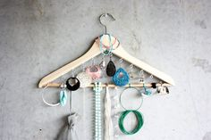 A few extra screw-in hooks turn a hanger into see-everything jewelry storage.