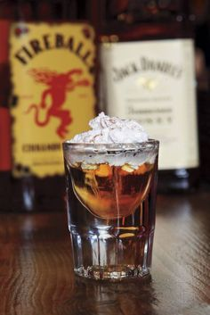Hot Lil' Honey  Ingredients: 1 oz. Jack Daniel's Tennessee Honey ½ oz. Fireball Cinnamon Whisky ½ oz. Frangelico  whipped cream  Method: Add ingredients to a shaker with ice. Shake and strain into a shot glass. Top with whipped cream.