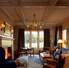 """Nothing nouveau riche here- this just says """"old money"""". I love the coffered ceiling & the gracious size of the room. It's so warm & inviting."""