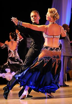 Mikolay Czarnecki and Charlene Proctor dance at the Cleveland Dancesport Championships 2013.  Photo by Alex Rowan.