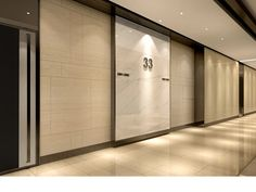 commercial office typical lobby interior design - stone and bronze