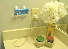 Make your own DIY phone charging station  by attaching command hooks to the wall. Let your phone rest there so you always know where it is