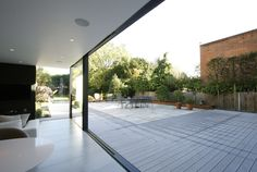 minimal windows to rear extension slid open to view the flush floor track from inside to outside  www.iqglassuk.com