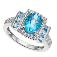 Sterling Silver 9 mm x 7 mm Blue Topaz & Lab-Created White Sapphire Halo Ring Emphasized with an array of genuine blue topaz and lab-created white sapphire stones, this halo ring abounds with enchanting appeal. Sapphire Stone, Blue Topaz Ring, White Sapphire, Halo Rings, Rings For Men, Engagement Rings, Sterling Silver, Jewelry, Enagement Rings