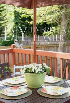Are you tired of your potted flowers always having to sit off-centered on your outdoor table because the umbrella pole is in the way? Look at this genius idea!