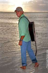 Jimmy Buffett, I think I've seen him 40 times. His music always puts me in a good mood.