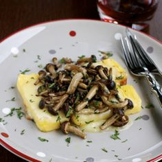 Polenta con Formaggio Fuso e Funghi (Polenta with Melted Cheese & Mushrooms) and the Dolomites.  Typical food at the Dolomite mountains.