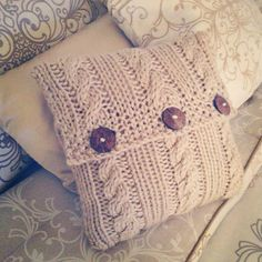 Cable knit pillow cover.