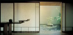 Tatami room with garden view in house by Chitoshi Kihara