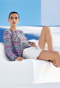 Indulge your wanderlust with this St. John eclectic Bellesa knit cardigan. Informed by a folkloric striped knit and a draped shawl collar, this colorful topper adds bohemian flair to sophisticated separates.