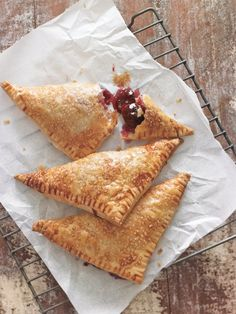 Flaky Cherry Turnovers - made with Bing cherries and not much cup to 2 cups cherries) Sweet Pie, Sweet Tarts, Just Desserts, Delicious Desserts, Yummy Food, Pavlova, Pie Dessert, Dessert Recipes, Breakfast Recipes