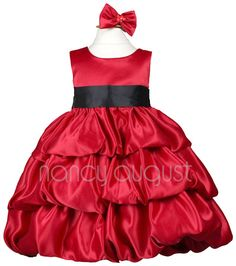Satin Red Baby Dress with Bubble Layered Skirt: This red baby dress is rich in color and in style. This red baby dress is made of quality satin that is soft to the touch. Simple and elegant with a removable waistband and triple bubble layered skirt with crinoline enhancement. Best of all you can pick your own customized sash color to match all your bridesmaid dresses! A undeniable treat for any baby girl for any joyous holiday occasion.