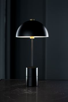 The iconic Studio Lamp series, designed by Laura Bilde, and the Globe Light series, designed by Emil Thorup, are part of the permanent lighting. Studio Lamp, Studio Table, Black Interior Design, Black Table Lamps, Hotel Decor, Brass Lamp, Globe Lights, Black Marble, Danish Design