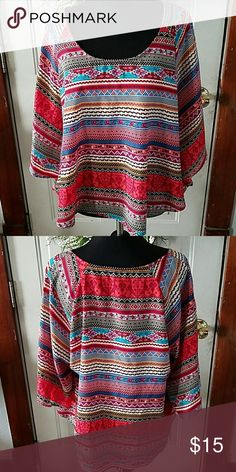 Colorful batwing top M This was my daughters and she wore it one time to a concert. No holes or stains. Smoke free home. Any questions please ask! Charlotte Russe Tops Blouses