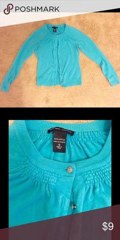 Teal Cardigan Teal cardigan is New York and company. Is great for the office. Also has decorative buttons. New York & Company Sweaters Cardigans