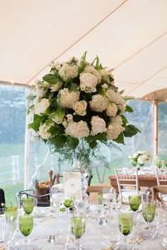 Outdoor Reception, Tall White & Green Centerpiece   Photo: Images by Berit, Inc.